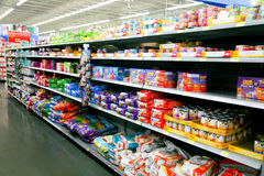 Pet Food at Store. Pet food on a store shelf. Canned cat wet food and bags of dry food are featured. Popular brands such as Whiskas, Science Diet, Meow Mix, and Royalty Free Stock Images