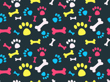 Pet footprints pattern. Cool pet background with dog paw prints and bones. Vector seamless texture Stock Photo