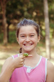 Pet frog. Happy Little girl holding her green tree pet frog royalty free stock photos