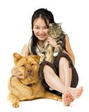 Pet Lover. Woman hugging her cat and dog Royalty Free Stock Images