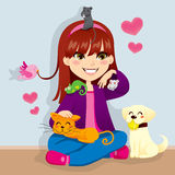 Pet Lover Girl. Pretty girl happy playing with her cute lovely little pets Stock Image