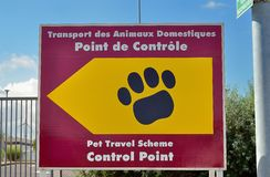 Pet passport animal control centre for travel to the United King. A sign pointing the way to the pet travel scheme control point prior to travel to the UK royalty free stock images