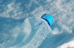 Pet plastic bottle on a snow Royalty Free Stock Images