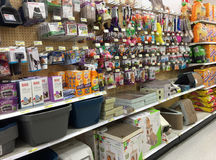 Pet products on shelves for sale at grocery store Stock Image