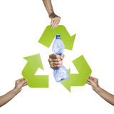 Pet recycling. Plastic and pet recycling- studio shot of a squeezed plastic bottle isolated on white background Stock Photos
