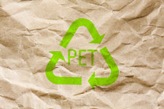 PET reuse. A brown wrinkled paper with reuse PET mark on Royalty Free Stock Photo