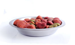 Pet`s food into a plate. Royalty Free Stock Image