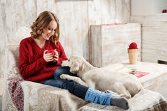 Pet's frienship. Young woman with her pet, golden retriever, relaxing together Royalty Free Stock Photo