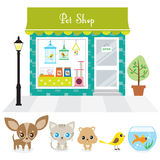 Pet Shop. Vector illustration of a pet shop with large window display on a street. Also includes illustration of chihuahua puppy, cat, hamster, bird, and Royalty Free Stock Photography