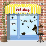 Pet shop store. Pet shop building.Facade of red brick. Barrel with birdcage on it at the fore, Cat, dog, birds and butterfly stickers on window. Vector Stock Photos
