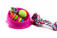 Pet supplies set about bowl, rope, rubber toys for dog. Or cat on white background royalty free stock image