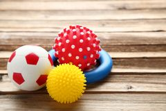 Pet toys. On brown wooden table royalty free stock photo