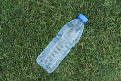 Pet Water Bottle On The Grass.  royalty free stock photos