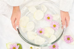 Petal bath. Woman's hands and soothing petal bath Stock Photo