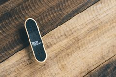 Tech Deck brand finger skateboard put on a wooden table background stock image