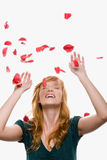 Petals falling on a woman Royalty Free Stock Images