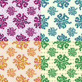 Petals of flowers set of 4 colored vector seamless geometric patterns on the background. (vector eps 10 Stock Illustration