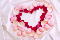 Petals heart. Valentine illustration: petals heart on a background of silk Stock Photo