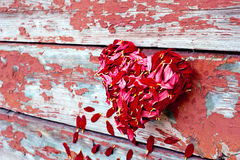 Petals heart and planks Royalty Free Stock Photography