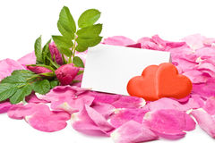 Petals, hearts and blank card Stock Images