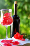 Petals of rose in glass of wine. Royalty Free Stock Images