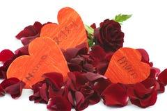 Petals of rose and handmade hearts royalty free stock photo