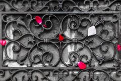 Petals of roses are scattered in front of the entrance door on the forged lattice royalty free stock photo