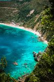 Petani beach on hot sunny summer day. View to Petani bay with transparent and crystal clear blue azure mediterranean sea Royalty Free Stock Images