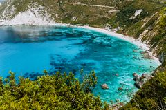 Petani beach in summer, Kefalonia island, Greece. View to Petani bay with transparent and crystal clear blue azure stock photography