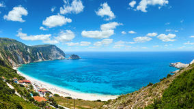 Petani Beach summer panorama Kefalonia, Greece. Deep blue sky with some cumulus clouds. All people are not recognize Royalty Free Stock Images