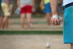 Petanque球在手中人 免版税库存图片