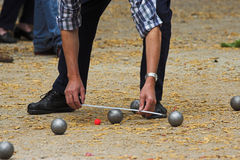 Petanque. Game in France, measuring the distance, deciding who's the winner Stock Photo