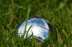 Petanque ball. On green grass Royalty Free Stock Photography