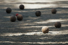Petanque ball boules bawl. S on a dust floor royalty free stock photography