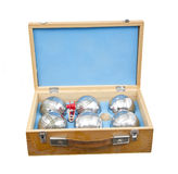 Petanque balls. Balls for the french game petanque in an pretty wooden case, isolated on white royalty free stock photography