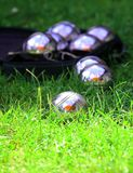 Petanque balls in a fresh green grass royalty free stock images