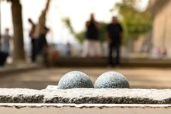 Petanque balls outdoors with blurry players in Saint-Malo, France. Close up of petanque balls outdoors with blurry players in Saint-Malo, France stock photos