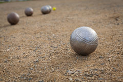 Petanque balls on a sandy pitch with other metal ball in the bac Stock Photography