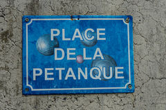 Petanque boule sign in washed out blue Stock Image