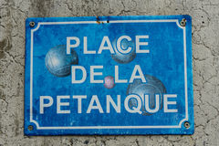 Petanque boule sign in washed out blue Royalty Free Stock Photo