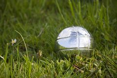 Petanque bowl in grass Royalty Free Stock Photo