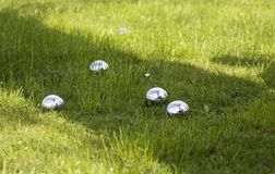 Petanque bowls on grass Stock Photo