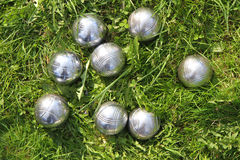 Petanque bowls in the green grass Royalty Free Stock Photo