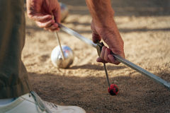 Petanque game,measuring the distance Royalty Free Stock Photo