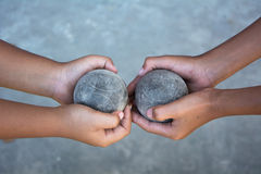Petanque. The hands of a man holding Petanque (boule) balls Royalty Free Stock Photo