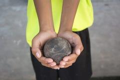Petanque. The hands of a man holding Petanque (boule) balls stock image