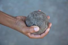 Petanque. The hands of a man holding Petanque (boule) balls stock photography