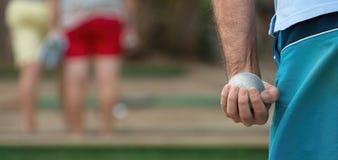 Petanque piłka w ręce mężczyzna Zdjęcie Royalty Free