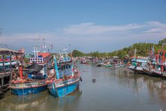 Fishing boats docked at the Port. Petchaburi, Thailand - March 21, 2018 :  Group of fishing boats docked at the Port of  river in fisherman village in Petchaburi Royalty Free Stock Images