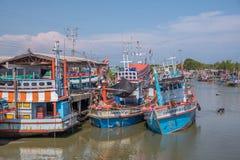 Fishing boats docked at the Port. Petchaburi, Thailand - March 21, 2018 :  Group of fishing boats docked at the Port of  river in fisherman village in Petchaburi Stock Photo